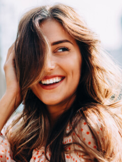 Woman smiling with a fresh hairdo.