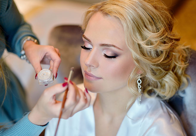 A bride getting her make-up done