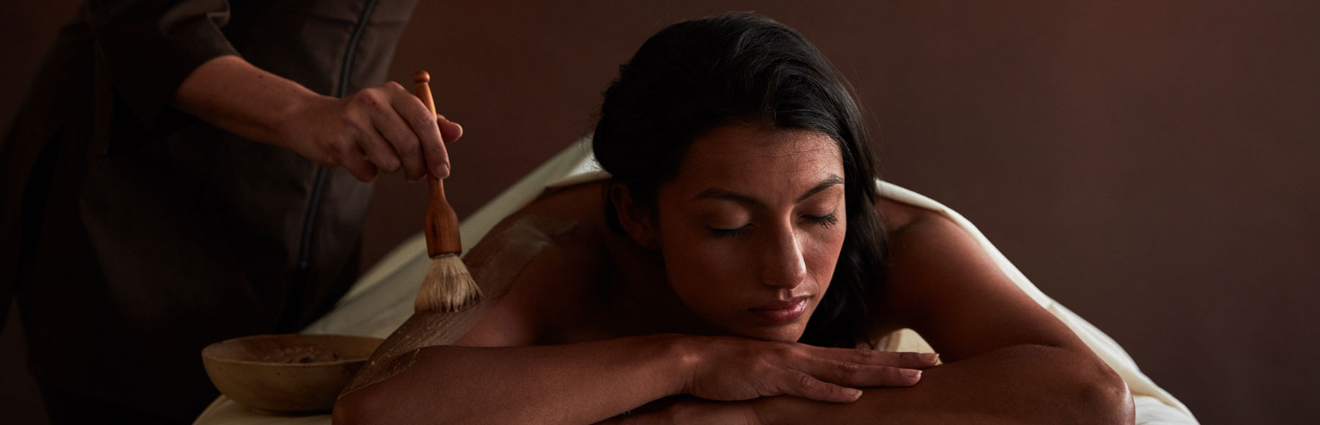 Woman getting a chocolate body treatment