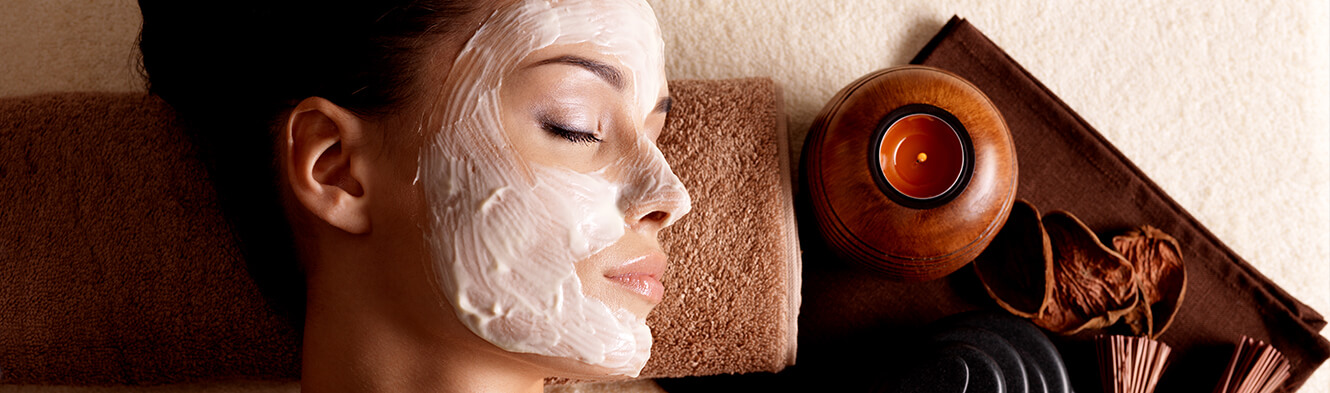 Woman lying down with facial mask